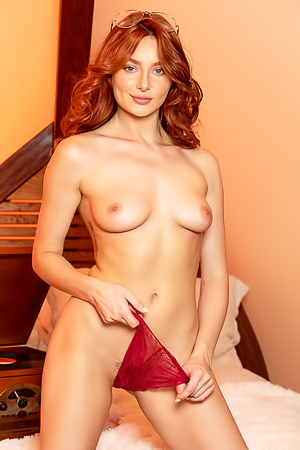 Redhead Model Lacy Lennon Playing With Banana