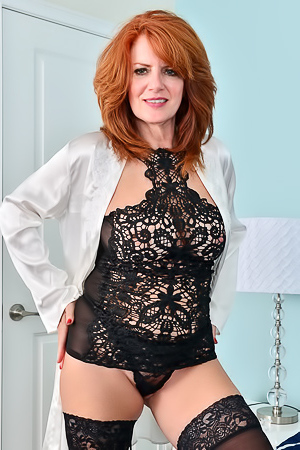 Andi James Ginger milf Andi James poses dressed in lace lingerie